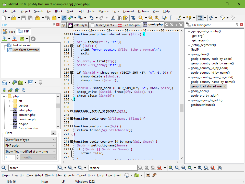 Editing a PHP script with EditPad Pro. The FTP Panel is docked to the left and the File Nagivator to the right.